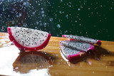 a splash of water drips into the pitaya