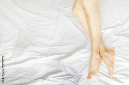 Woman Body Legs Bed Awaking Morning Step Female Foot Sleep Relax Concept. - 209975972