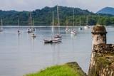 Sail boats and Fuerte Santiago fortress in Portobelo village, Panama - 209979940