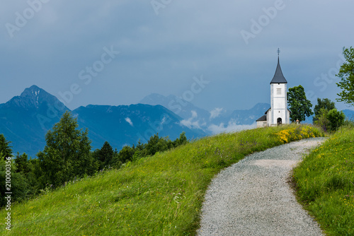 Fridge magnet Church of St. Primus and Felician, Jamnik Slovenia at stormy weather