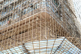 In Hong Kong and China and other parts of Asia, bamboo is often used for scaffolding for real estate construction in place of steel or iron scaffolds © robert cicchetti