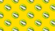 A seamless pattern with green kiwi on a yellow background - 210016937