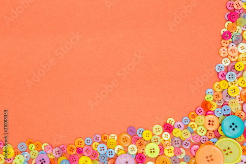 Foto Murales Colourful buttons on an orange background with copy space.