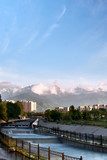 Snow-capped high mountains over Almaty at the evening. View from the big Almaty river