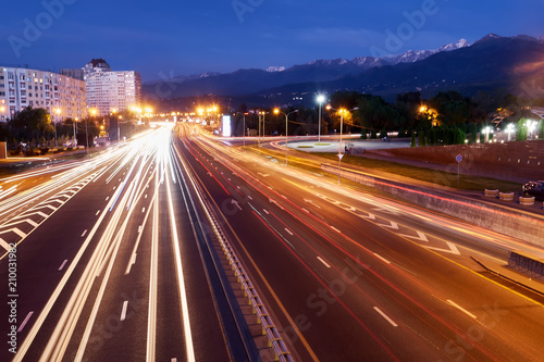 Fotobehang Nacht snelweg Almaty city night view. Lights trails at night on the road Avenue Al-Farabi
