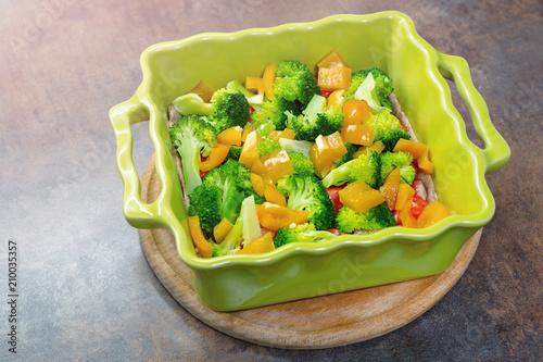 Ceramic baking dish with fresh vegetables. Organic vegetarian meal. Healthy vegetable eating. Summer vitamine food © Kirill Gorlov