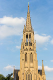 Poland, Katowice - 12/06/2018: catholic cathedral against blue sky. Church facade. Religious journey. Europe travel. Polish landmark.