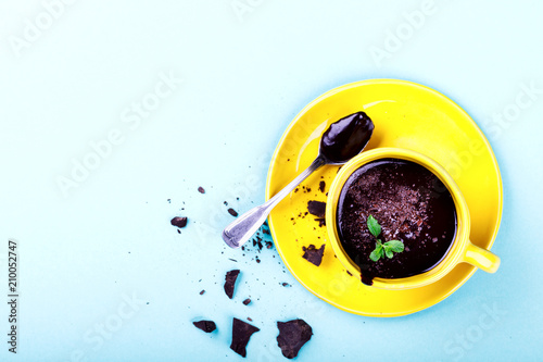 Fotobehang Chocolade Hot Chocolate with Green Mint in Yellow Cup Drink Dessert on Colorful Background Top View Copy space for Text Flat Lay