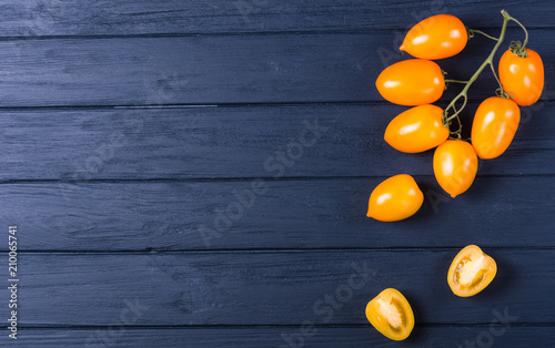 Foto Murales Yellow tomatoes on branch