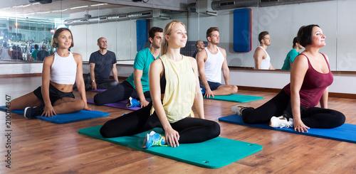 Obraz na płótnie Adults having yoga class in sport club