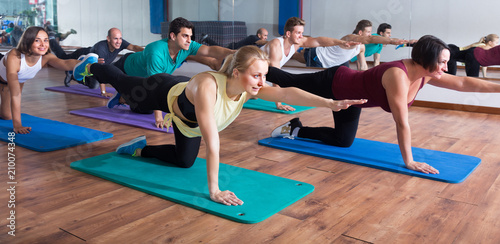 people exercising in dance hall - 210074348