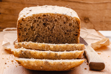 Sliced whole wheat bread on cutting board