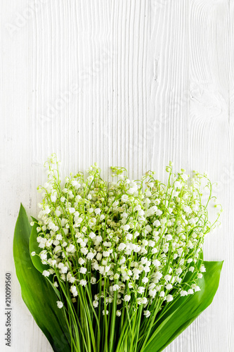 Foto Murales May flowers. Bouqet of lily of the valley flowers on white background top view copy space