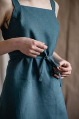 hands adjusting the natural dress