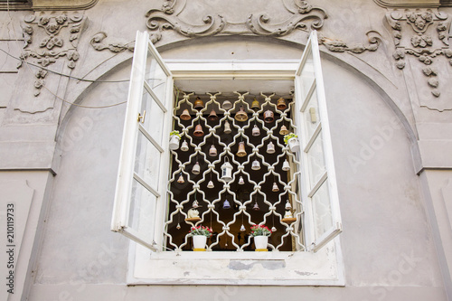 Prague, Czech Republic, May 26, 2018: Window detail with funny bell decoration