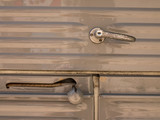 detail on handle of a door of an oldtimer pickup truck