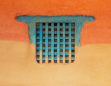 Traditional wooden Nepalese window called Ankhi jhyal. Painted blue on orange and ocher mud wall. - 210136597