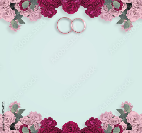 Top view of pink roses and bridal rings for wedding