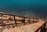 Wooden Stairs to the sea. Vacation Travel Walking Concept - 210146124
