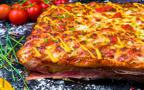 Homemade meat pizza pie with bacon sliced close-up on the table. horizontal view from above. - 210152947