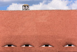 Famous eyes. Windows in the roof made in the form of eyes. - 210162372