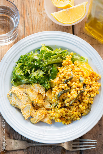 Fiery Moroccan chicken with giant spicy couscous, roasted vegetables and tzatzaki dressing  - 210165309