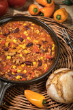 Chili con carne in a clay pan. - 210173574