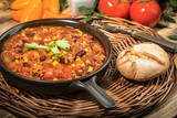 Chili con carne in a clay pan. - 210173726