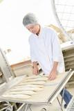 woman baking bread - 210175151