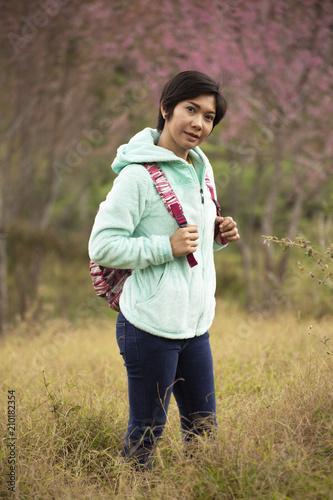Fototapeta Asian woman stand among Pink flower King of tigers