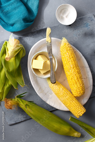 Recipe cooking sweet corn Raw sweet corn butter salt top view - 210183341