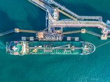 oil tanker, gas tanker in the high sea.Refinery Industry cargo ship,aerial view,Thailand, in import export, LPG,oil refinery, Logistics and transportation with working crane bridge in harbor - 210189796