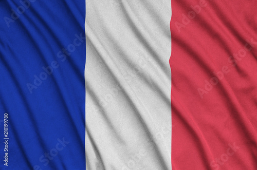 Foto Murales France flag  is depicted on a sports cloth fabric with many folds. Sport team banner