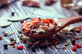 dried vegetables in a wooden spoon - 210208726