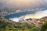 View from above on the old city Kotor, big cruise liner in Adriatic sea and mountains at Montenegro at the sunset time, gorgeous nature landscape - 210208773