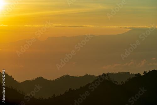 Fotobehang Meloen Majestic and misty sunrise over mountain range at Bromo Tengger Semeru National Park, Indonesia.