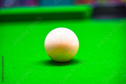 Billiard ball in a green pool table focus on white ball - 210262973