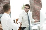handshake business partners after the deal - 210275563