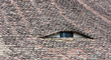 Famous eyes. Windows in the roof made in the form of eyes. - 210289750