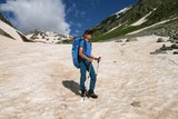 Tourist walking on snow in the Caucasus mountains