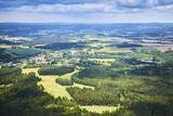 Aerial view of South Bohemian landscape with fields, forests and dramatic sky in Czech Republic.