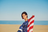 A young woman holding the us flag - 210310972