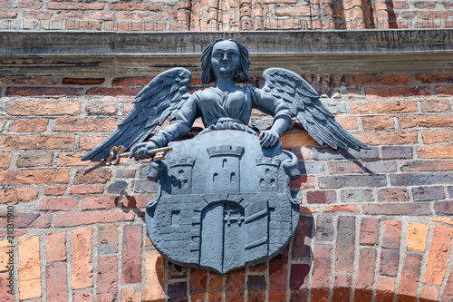Fototapeta Torun, Poland - medieval arms, emblem of the city above the gate to the town