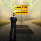 Businessman stands on crossroad between