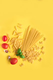 Ingredients for pasta on yellow - 210347931