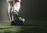 Football fans in stadium - 210351714