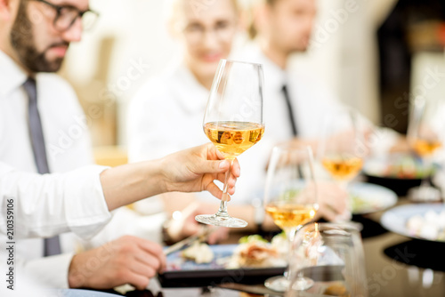 Close-up view on the delicious meals and wine during a business lunch at the restaurant - 210359106