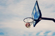 Basketball hoop with ball in net, shooting around for sport game practice.
