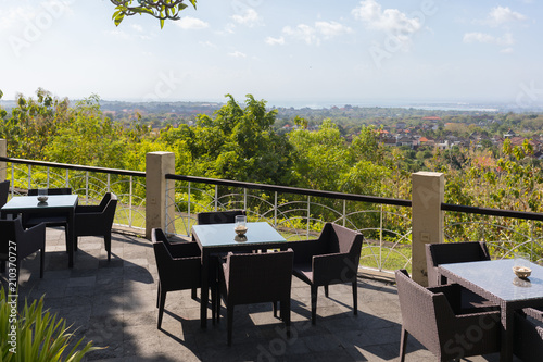 Tables with a panoramic view for the visitors of Garuda Wisnu Kencana Cultural Park - 210370727