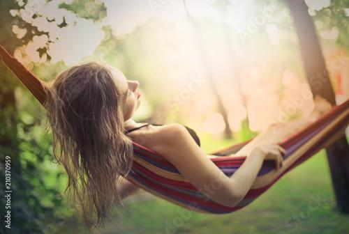 Leinwanddruck Bild Sleeping on the hammock